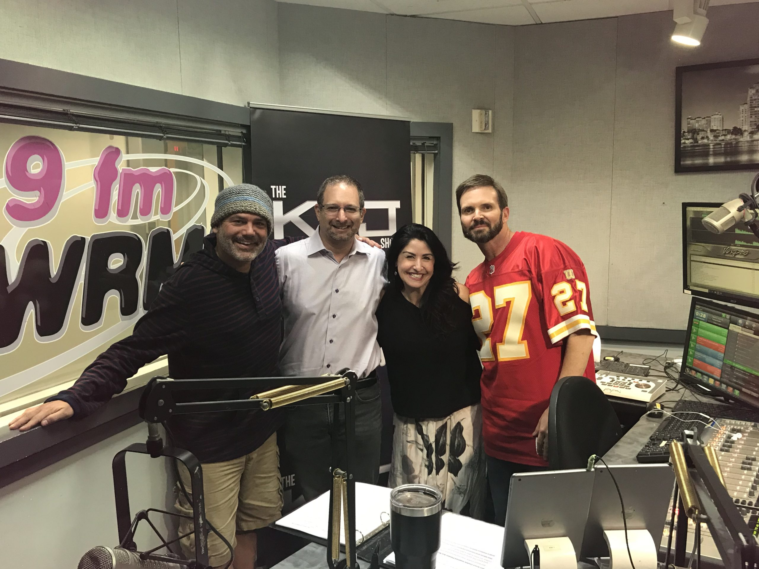 RBR+TVBR Editor-in-Chief Adam R Jacobson (second from left) poses with members of the KVJ Show at WRMF-FM in West Palm Beach in this January 2020 file photo.
